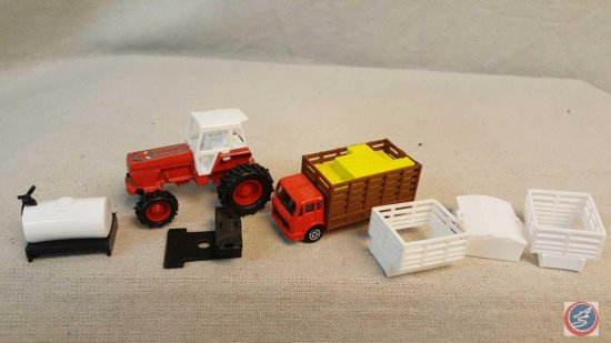 Red Benz truck with stake box and hay bales, Case red tractor with bulls on the hood, and (5) pieces