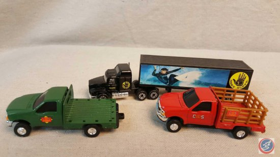 "(2) ERTL die cast Ford trucks, and (1) Matchbox semi with trailer marked ""Body Glove"""