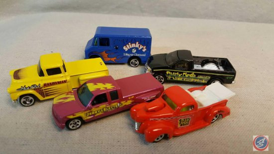 "(5) Hot Wheels die cast trucks including ""Stinky's Diaper Cleaners"", ""Rusty Pipes Plumbing"", ""Pizza"