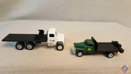 (2) ERTL die cast trucks, International and a 50's Chevy truck with flatbed