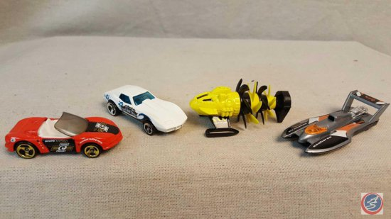 "(4) Hot Wheels die cast cars from the ""Ocean Blasters"" series."