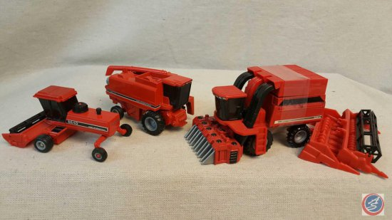 (3) ERTL die cast cars marked: Combine 1666, Hay Mower 8840, Cotton Raker 2555