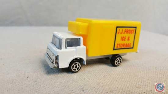 "White 60's Ford with yellow box marked ""JJ Frost Iced Storage"""