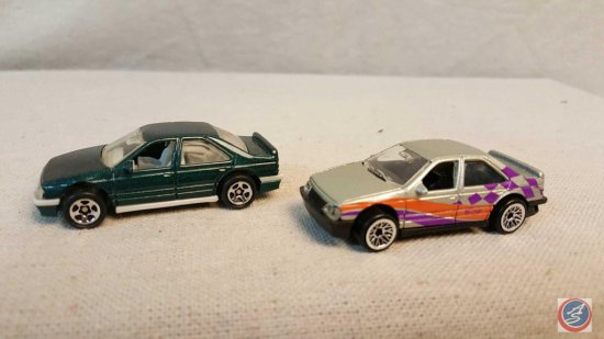 (2) Hot Wheels die cast cars marked: Peugeot 405
