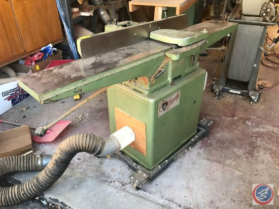 Grizzley 8 inch planer on Shop Fox Casters