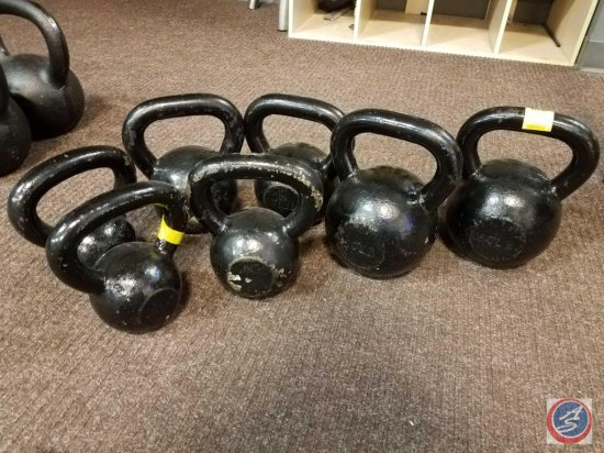 7 kettle bells pair of 50 lbs., 35 lbs,20 lb,and a single 25 lb.