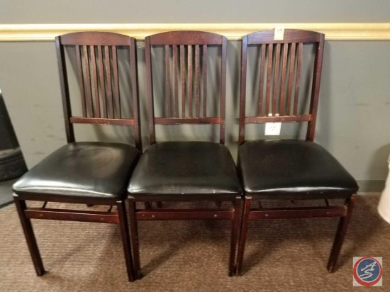 3 upholstered wooden folding chairs