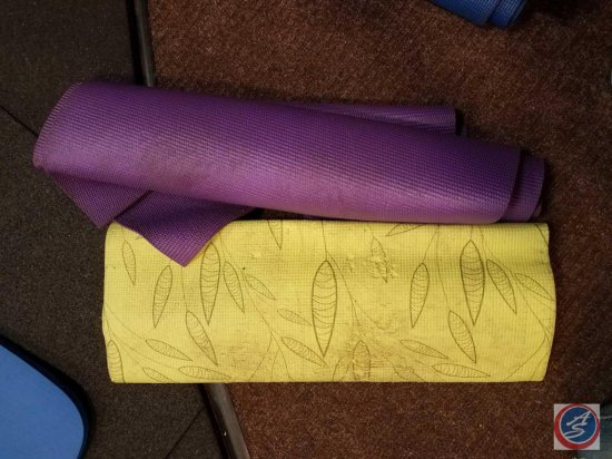 2 rubber Pilates mats with designs