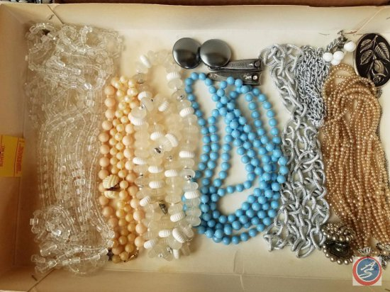 Necklaces, Clip on Earrings, and Nail Clippers