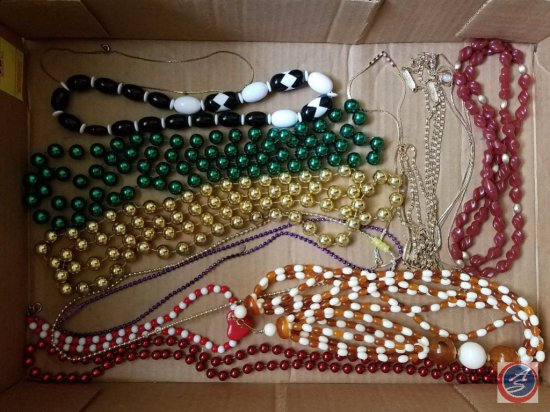 Variety of costume jewelry including necklaces and Bracelets