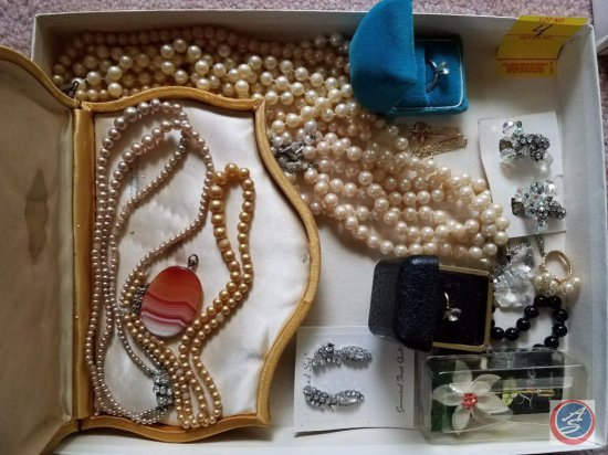 Variety of costume jewelry including necklaces, Bracelets, and rings