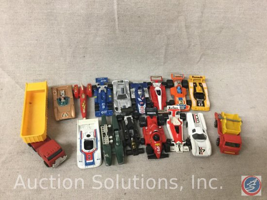 (16) Tomica and Matchbox Race Cars and Dump Trucks