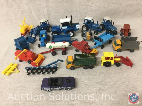 (19) Ertl and Matchbox Tractors and equipment: Blue Ford TW-35, Blue Ford FW-60, Blue Tractor Baler,