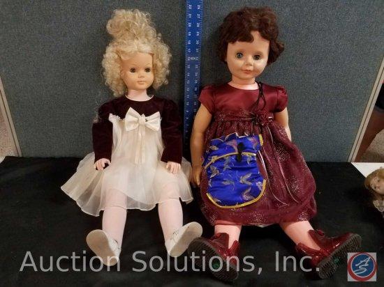 (2) large plastic dolls