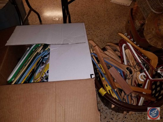 Large box and tote of plastic hangars