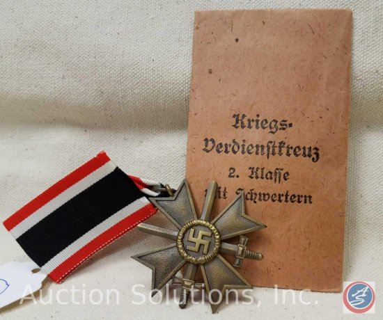 German World War ll 2nd Class war service cross with swords. The suspension ring is maker marked '1