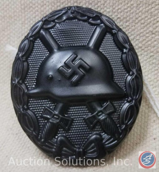 German World War II Black Wound Badge. Has a thin vertical pin back. Black painted steel