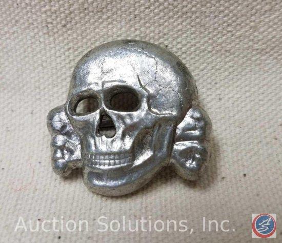 German World War II Waffen SS Officers Visor Cap Skull. The reverse side is maker marked 'RZM M1/25
