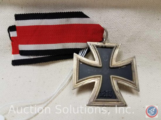 German World War ll 2nd class Iron Cross. The suspension ring is maker marked '65 '. Includes the