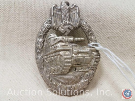 German World War II Army Silver Tank Assault Badge. Has a thin vertical pin back. Stamped nickel