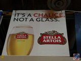 Stella Artois paper sign with styrofoam backing (54 X 48)- need ladder to remove