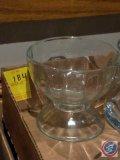 box full of glass pedestal sundae dishes