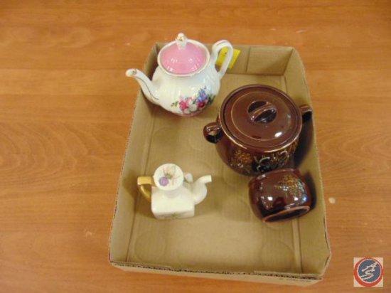 decorative ceramic teapot, ceramic bowl with lid and handles, smaller ceramic bowl, decorative