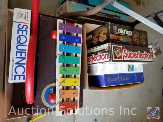 "(2) boxes containing assorted children's games including ""Superfection"" ""Scrabble"", and ""Simon"""