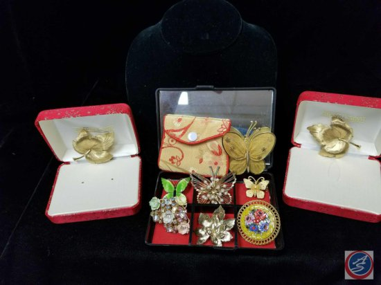 (9) assorted brooches, including butterflies, and leaves