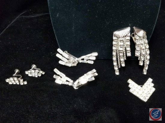 (3) sets of rhinestone earrings, and a small rhinestone brooch