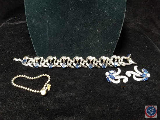 Blue rhinestone clasp bracelet with matching clip on earrings, and
