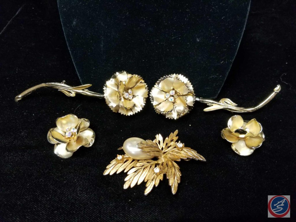(2) matching intricate flower brooches with matching clip on earrings