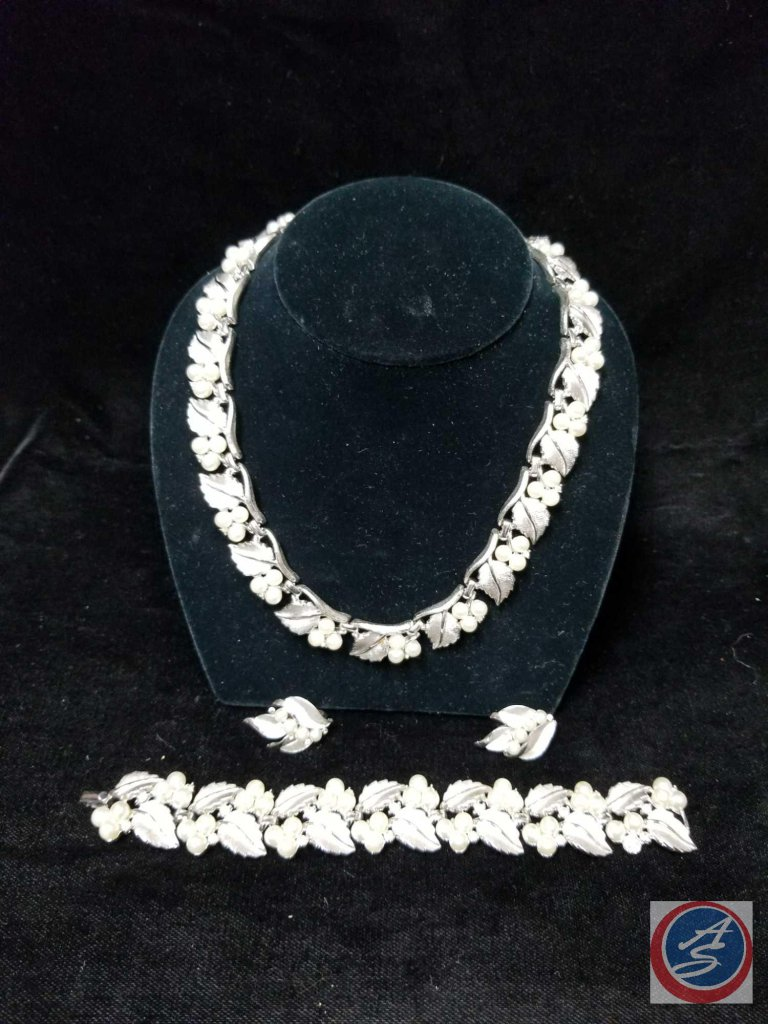 Set including necklace, clip on earrings, and matching bracelet