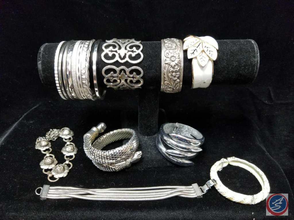 (6) hinged cuff bracelets, multi strand bracelet, clasp bracelet, and bangles