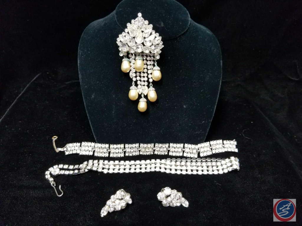 Large rhinestone and pearl brooch with (2) clasp bracelets and rhinestone clip on earrings