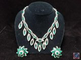 Green rhinestone necklace with clip on earrings set.