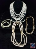 (3) multi strand imitation pearl necklaces, and (1) single strand
