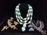 (2) beaded multi strand necklaces with matching earrings, and metal beaded clasp bracelet with