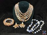 Multi strand beaded neckalce with matching bracelet and earrings, and single strand beaded necklace