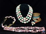 (2) beaded multi strand necklaces, (9) bangles, and necklace missing some pieces