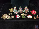 Assortment of Christmas brooches and earrings