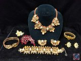 Set including necklace, clip on earrings, and matching bracelet, also includes (2) bracelets,