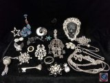 Variety of brooches, collar clips, necklaces, and more