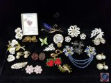 Variety of brooches, collar clips, necklaces, earrings, and more