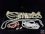 (2) multi strand necklaces, (2) single strand necklaces, and a pair of clip on earrings