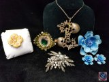 (3) brooches, a brooch and clip on earrings set, and a large silver pendant with chain, marked