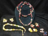 Beaded multi strand necklace with matching clip on earrings, single strand necklace, and (3) sets of