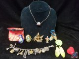 Native American charm bracelet and beaded pins, oriental vase with pouch, and more