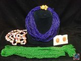 (3) multi strand necklaces, and a pair of clip on earrings