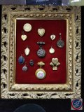 Several antique lockets on framed velvet (PERSONAL PHOTOS HAVE BEEN REMOVED)